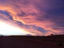 Gesetzte Wolken pedy Sonne Coober Lizenzfreies Stockfoto