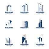 Gesetztes Vektordesign des blaues Grau Gebäudelogos stock abbildung