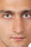 Gesicht des jungen Mannes. Schließen Sie herauf Makroportrait Lizenzfreies Stockbild
