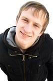 Gesicht des lächelnden freundlichen Mannes, der Kamera betrachtet Lizenzfreie Stockbilder
