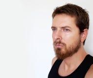 Gesicht des stattlichen Mannes getrennt auf Weiß Stockfotografie