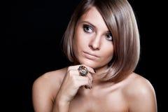 Gesicht eines schönen blonden Mädchens Stockfotos