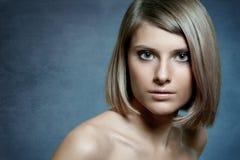 Gesicht eines schönen blonden Mädchens Stockbild