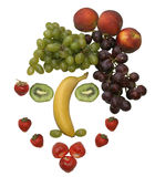 Gesicht gebildet aus verschiedenen Früchten heraus Stockfoto