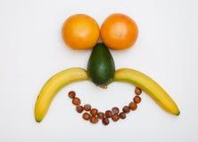 Gesicht gebildet von den Früchten stockbild