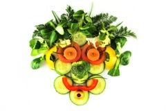 Gesicht gebildet von den Gemüsescheiben Stockfotografie