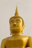 Gesicht großen goldenen Buddha-Stucks an Wat Klong-reua Phitsanulok, Lizenzfreies Stockfoto
