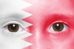 Gesicht mit Bahrain-Flagge Lizenzfreies Stockfoto