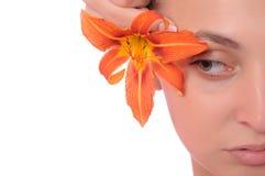 Gesicht mit einer Blume Stockfotografie