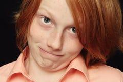 Gesicht verziehendes Junge Lizenzfreie Stockbilder