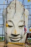 Gesicht von Buddha mit blauem Himmel Stockfotografie