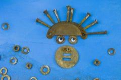 Gesicht von den rostigen Schrauben und von den Teilen Lizenzfreies Stockbild