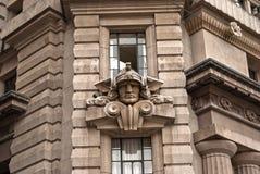 Gesicht von hermes auf Gebäude Stockfotografie