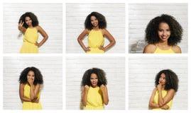 Gesichtsausdrücke der jungen schwarzen Frau auf Backsteinmauer Stockfoto