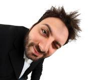 Gesichtsausdruck des verrückten jungen Geschäftsmannes stockbild