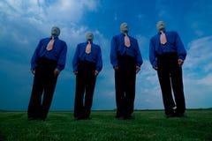 Gesichtslose männliche Gruppe Stockbild