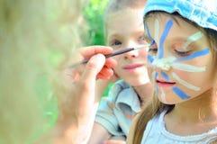 Gesichtsmaske cjild Karnevalsanstrich Stockbilder