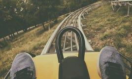 Gesichtspunkthinterhof-Achterbahnfahrt Stockbilder