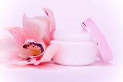 Gesichtssahne und rosafarbene Orchidee Stockfoto