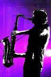 Gesilhouetteerde saxofoonspeler Royalty-vrije Stock Afbeeldingen