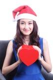 Gesloten omhoog Aziatische vrouw met een Kerstmishoed Stock Foto's