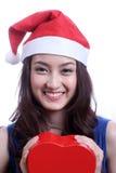 Gesloten omhoog Aziatische vrouw met een Kerstmishoed Stock Afbeeldingen