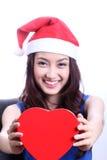 Gesloten omhoog Aziatische vrouw met een Kerstmishoed Stock Fotografie