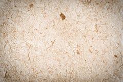 Gesloten omhoog bruin moerbeiboomdocument met houtpulpachtergrond Royalty-vrije Stock Foto's