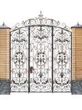 Gesmede omheining en deuren met decor Royalty-vrije Stock Foto's