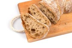 Gesneden brood op scherpe raad Royalty-vrije Stock Fotografie