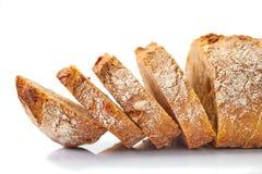 Gesneden brood op wit Stock Fotografie