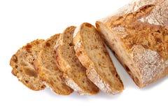 Gesneden brood op wit Stock Afbeelding