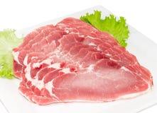 Gesneden gekoeld varkensvleeslendestuk met slaclose-up stock fotografie