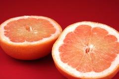 Gesneden Grapefruit Stock Afbeeldingen