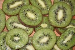 Gesneden kiwivruchten achtergrond dicht omhoog stock afbeeldingen