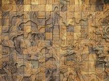 Gesneden muurbeeldhouwwerk in de tempel van Thailand royalty-vrije stock foto
