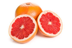 Gesneden rode grapefruit op wit Stock Foto