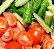 Gesneden tomaten en komkommers Royalty-vrije Stock Afbeelding