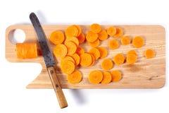Gesneden wortel op hakbord Stock Foto