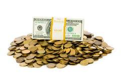 Geïsoleerde= dollars en muntstukken Stock Foto