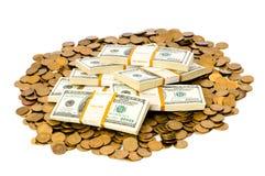 Geïsoleerde dollars en muntstukken Stock Foto's