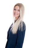 Geïsoleerde jonge blonde glimlachende onderneemster in kostuum over witte B Royalty-vrije Stock Afbeelding