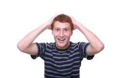 Geïsoleerde jonge verbaasde mens gelukkig het kijken Royalty-vrije Stock Fotografie