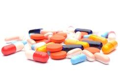 Geïsoleerde pillen Stock Afbeeldingen