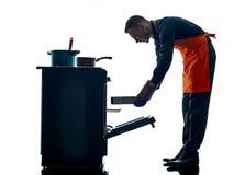 Geïsoleerde silhouet van de mensen het kokende chef-kok Stock Foto's