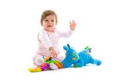 Geïsoleerde spelen van de baby Stock Fotografie