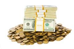Geïsoleerdeg dollars en muntstukken Stock Fotografie