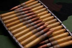 Gesorteerde munitie op militaire achtergrond Stock Foto