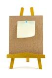Gespelde nota over corkboard met houten tribune royalty-vrije stock fotografie