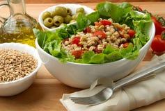 Gespelde salade Stock Foto's